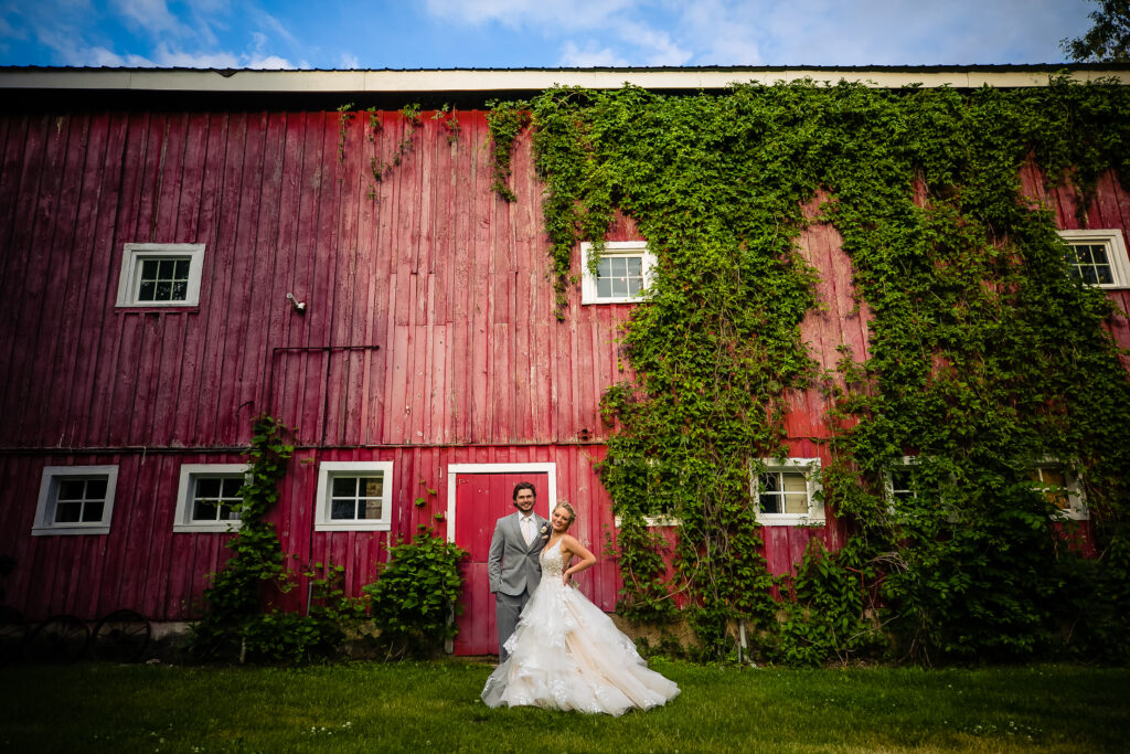 bride and groom outside barn